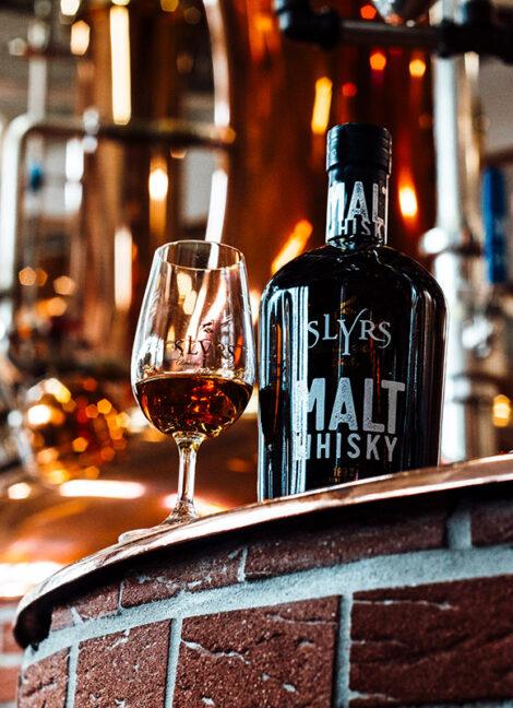 slyrs single malt on stone bar